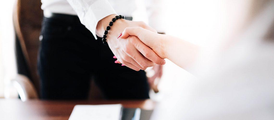 business-man-and-woman-handshake-in-work-office-picjumbo-com (3)